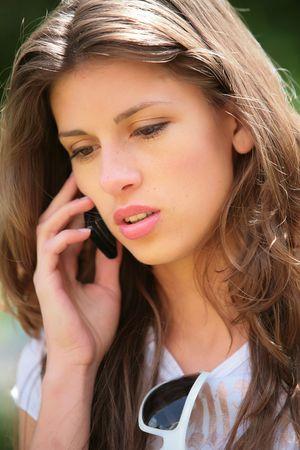 speaks: long-haired girl speaks on mobile phone