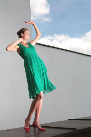 dancing girl in green dress and red loafer photo