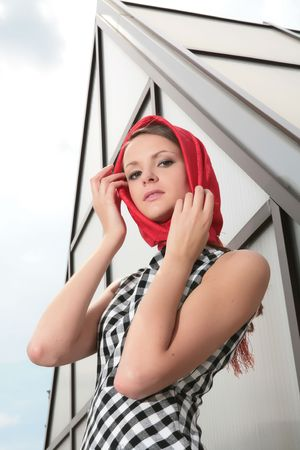 gracefully: beautiful girl gracefully corrects red kerchief Stock Photo