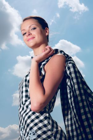 splendid: young and beautiful girl on background blue sky with cloud Stock Photo