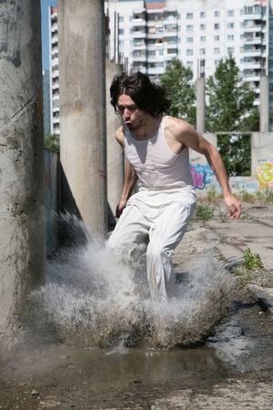 dripped: man in white cloth jumps in water, raising dripped Stock Photo