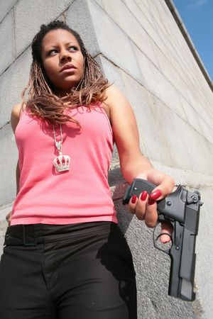 serious gangster woman in tanktop with big black gun Stock Photo - 3644159