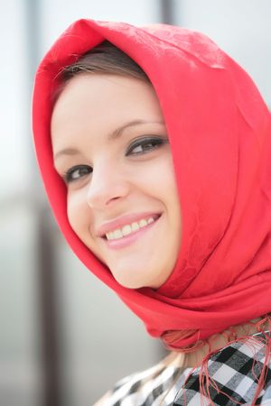 beautiful smiling girl in bright red kerchief photo