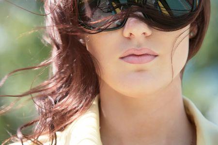 splendid: Gorgeous girl close-up portrait in sunglasses on wind