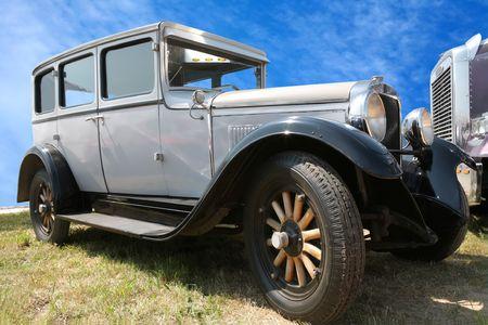light-gray retro car on wooden wheel photo
