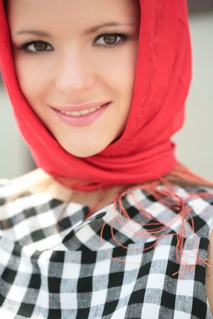 close-up portrait of the beautiful girl in plaid gown with red kerchief Stock Photo - 3791585
