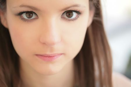 splendid: closeup portrait of the young girl with magnetic glance Stock Photo