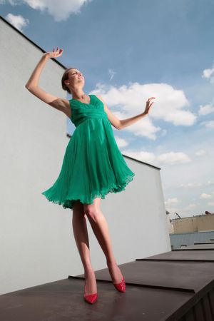 loafer: girl in green dress and red loafer dances on celestial background with clouds