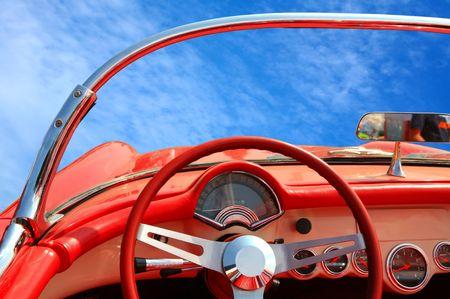 red stylish car on background blue sky photo