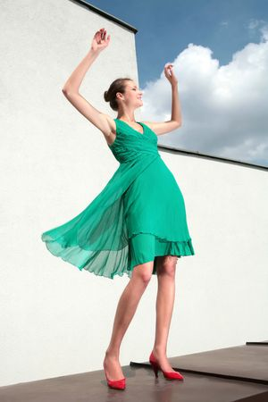 loafer: dancing girl in green dress and red loafer Stock Photo