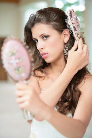 splendid: beautiful girl combs luxurious dark hairs, does hairstyle