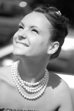 splendid: close-up monochrome portrait beautiful smiling girl with pearl necklace Stock Photo