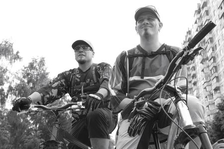 onward: two serious bicyclists look onward, monochrome Stock Photo