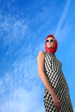 splendid: young girl in image of the 50-h on blue sky background with copy-space