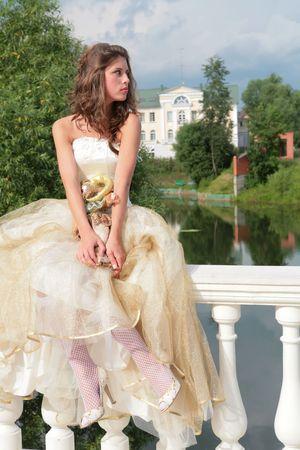 pretty princess in white-golden gown dreams of future photo