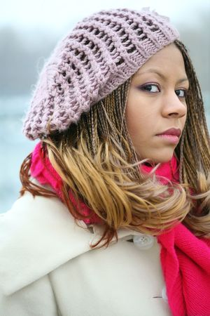 portrait of the beautiful young woman in lilac beret with red scarf photo