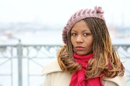 black serious girl on white winter day photo