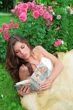 portrait of the princess with book in hand in the flowers Stock Photo - 4207183