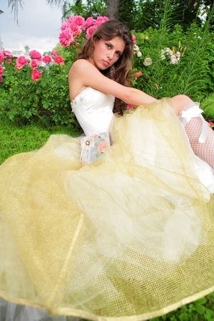 portrait of the beautiful girl in white-golden gown photo