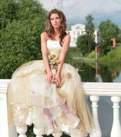 splendid: pretty princess in white-golden gown dreams of future