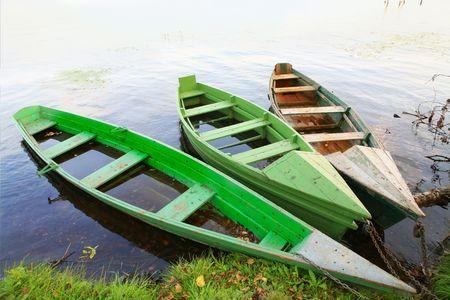 three wooden boats near coast Stock Photo