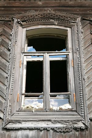 splinter: window of the old-time building with splinter glass, Ural culture, Russia,