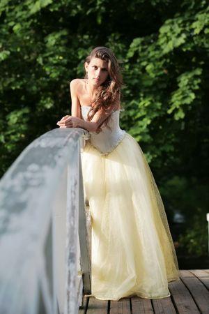 splendid: beautiful bride on the wooden bridge