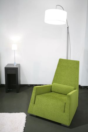 fragment of the home inter with green easy-chair and floor-lamp  Stock Photo - 4659161