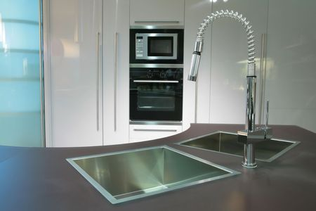 modern metallic sink with graceful tap on the super-modern kitchen