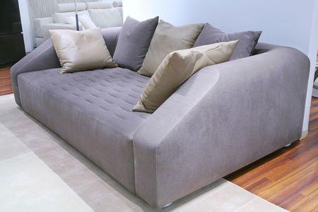 furniture, velour sofa with leather pillows Stock Photo - 4659167