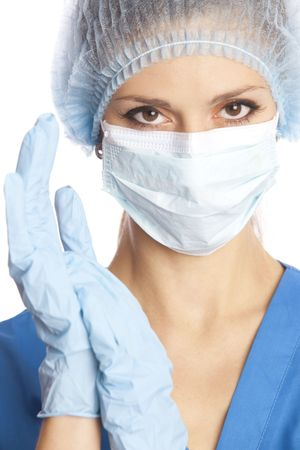 Close-up portrait of young female doctor in surgeon's cap, mask and gloves Stock Photo - 5805015