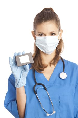 Young female medical specialist in mask and gloves holding in her hand box with copy-space photo
