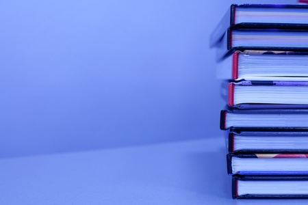 stack of books on the table in blue color. with copy-space Stock Photo - 13327501