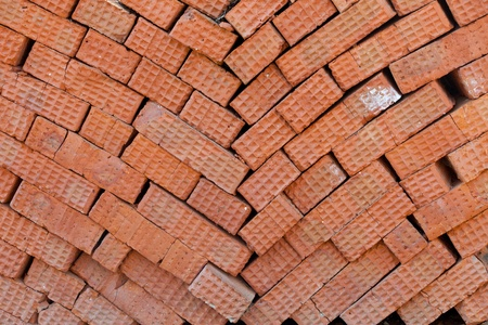 abstract background of stacked red bricks photo