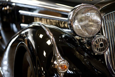 headlamp: part of a black old car with headlamp Stock Photo