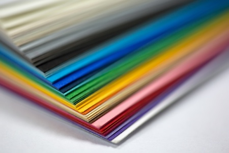 edge of the stack of colored paper for artwork photo
