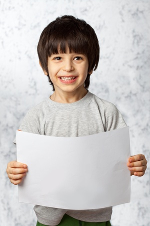 laughing boy  showing  displaying placard ready for your text or product photo