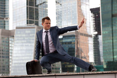 businessman in a defensive stance Stock Photo