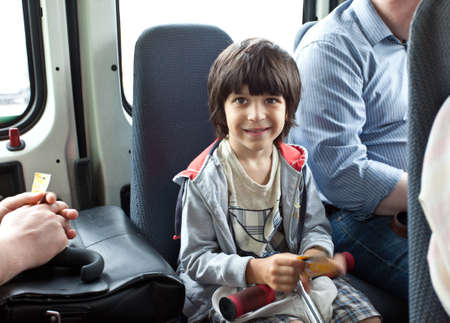 boy in a public transport photo