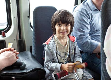 boy in a public transport Stock Photo