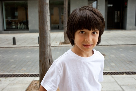 european boy in a white T-shirt on the street photo