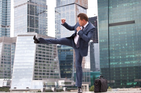 combative: businessman strikes, combative training before the office Stock Photo