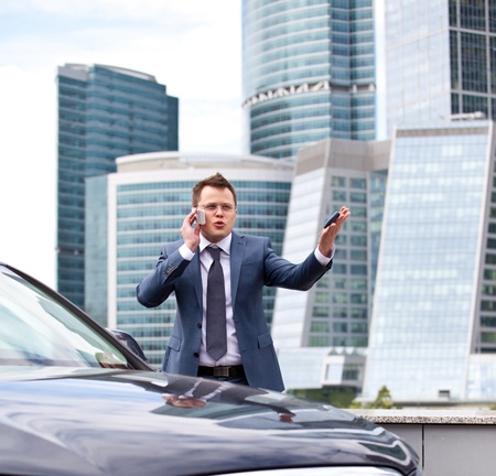 Successful businessman on the background of office center photo