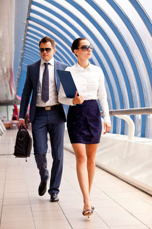 businessmeeting: businesswoman and a bodyguard go to a business meeting