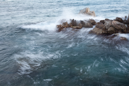 foaming: rocky and the waves, shot long exposure