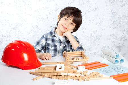 boy plans to build a new house photo