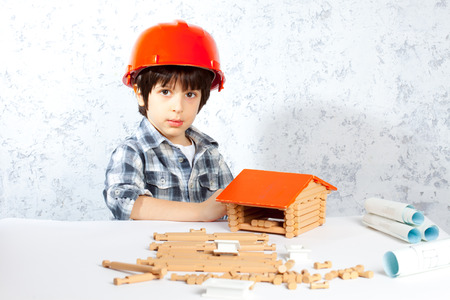 boy builder in red helmet  built a new home photo