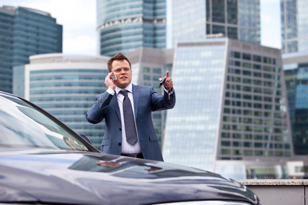 financier: businessman talking on the phone and pointing her finger Stock Photo