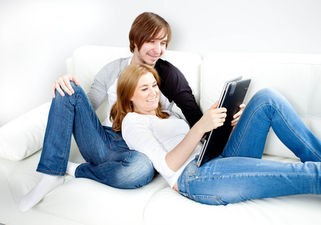 Couple relaxing at homeon sofa photo