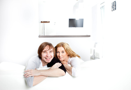 happy couple in new home Stock Photo - 28025184